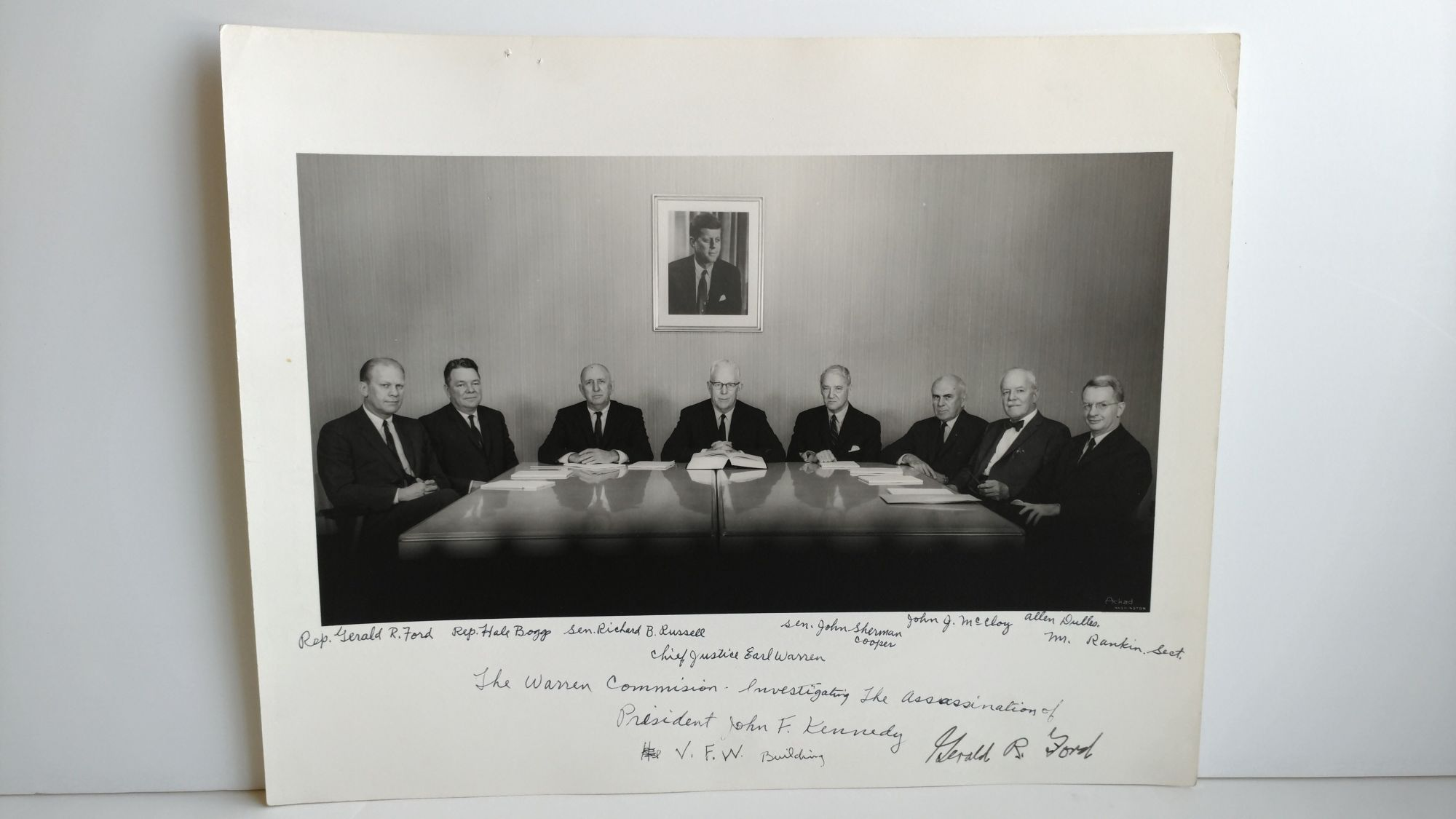 PHOTOGRAPH OF THE WARREN COMMISSION SIGNED BY GERALD FORD. Abdon Daoud Ackad.