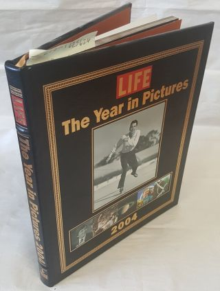 LIFE : THE YEAR IN PICTURES--2004. Robert Andreas, Barbara Baker Burrows, Director of Photography