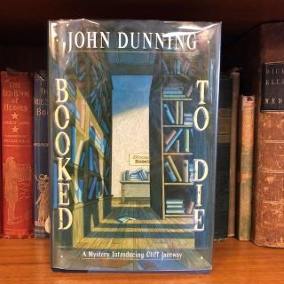 Booked to Die: A Mystery Introducing Cliff Janeway [signed]. John Dunning