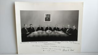 PHOTOGRAPH OF THE WARREN COMMISSION SIGNED BY GERALD FORD. Abdon Daoud Ackad