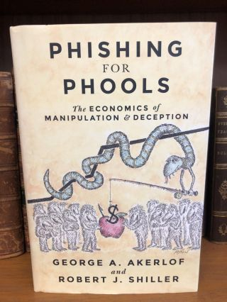PHISHING FOR PHOOLS [SIGNED]. George A. Akerlof, Robert J. Shiller